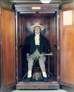 Bentham's body in cupboard